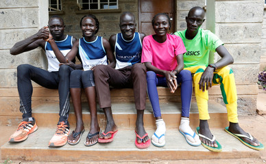Athletes from South Sudan, part of the refugee athletes who qualified for the 2016 Rio Olympics, pose for a photograph after a training session at their camp in Ngong township near Kenya's capital Nairobi