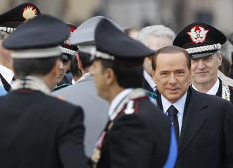 Italian Prime Minister Silvio Berlusconi arrives at the Vittoriano monument on Piazza Venezia in Rome
