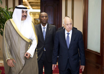 Kuwait's FM Al Sabah escorts Arab League Secretary-General Elaraby and Chief of Staff of the African Union Natama in Kuwait City