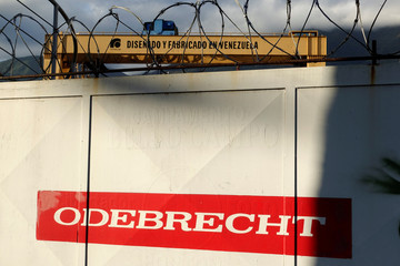 "The corporate logo of Odebrecht is seen next to a text in a structure that reads ""Designed and made in Venezuela"" in a construction site in Caracas"