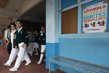 Students take part in an earthquake evacuation drill at Heroes de Chapultepec school in Mexico City