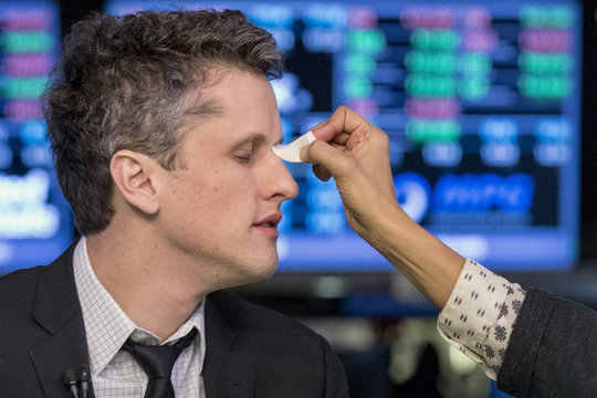 Box Inc Co-Founder and CEO Levie has make-up applied before an interview on the floor of the New York Stock Exchange, after his company's IPO