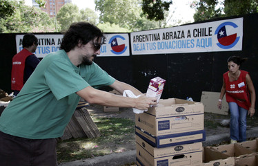 A man arrives with donations for those who were affected by the recent 8.8-magnitude earthquake and ensuing tsunamis in Chile, before a benefit concert, in Buenos Aires