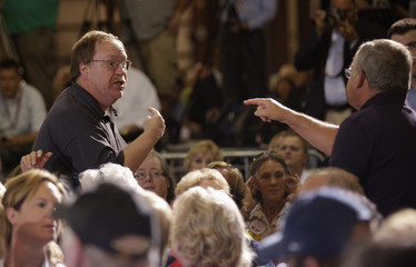 Unidentified man who shouted at Republican U.S. presidential candidate Romney argues with another at LeClaire Manufacturing in Bettendorf