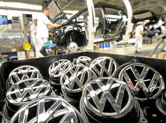 File photo of emblems of VW Golf VII car pictured in a production line at the plant of German carmaker Volkswagen in Wolfsburg