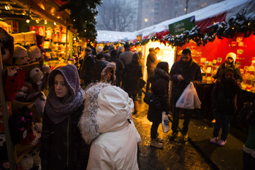 People shop at holiday vendors near Central Park in New York