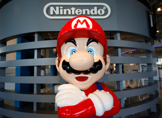 "A figure depicting ""Mario"", a character in Nintendo's ""Mario Bros."" video games, is displayed at the company showroom in Tokyo, Japan"