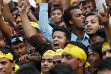 Activists of Bangladesh Awami League shout slogans during a rally in Dhaka.