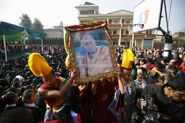 Tibetan monks carry portrait of Dalai Lama, during function commemorating 25th Anniversary of Nobel Peace Prize conferment to exiled Tibetan spiritual leader Dalai Lama and 66th International Human Rights Day in Kathmandu