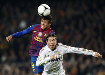 Real Madrid's Ramos fights for the ball with Barcelona's Alexis during their Spanish King's Cup quarter-final soccer match in Barcelona