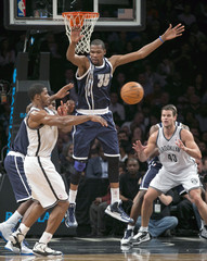 Oklahoma City Thunder Kevin Durant leaps block pass from Brooklyn Nets Joe Johnson to forward Kris Humphries in NBA game in New York