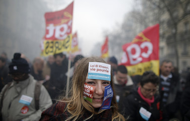 Protestors and French labour union workers attend a demonstration against the French labour law proposal in Paris