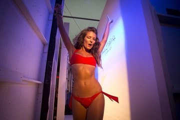 Model walks  in the backstage area during Frankie's Bikinis show at Mercedes Benz Swim Fashion Week in Miami