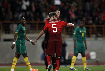 Portugal's Coentrao celebrates his goal against Cameroon with teammate Ronaldo during their international friendly soccer match at Leiria stadium