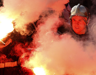 French firefighters light flares during a demonstration outside the European Commission headquarters in Brussels