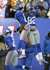 New York Giants Randle celebrates scoring a touchdown against the Philadelphia Eagle in the first quarter during their NFL football game in East Rutherford