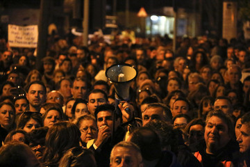 Thousands of bank employees protest outside the parliament in Nicosia