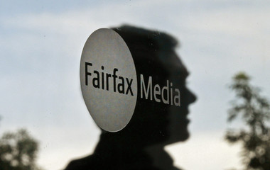 A man leaves the Fairfax Media headquarters in Sydney