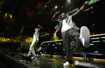 Canadian singer Justin Bieber performs with Sean Kingston during the Z100 Jingle Ball in New York