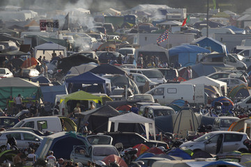 Fans camp at Le Mans circuit during the Le Mans 24 Hours motorcycling endurance race