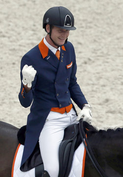 Netherlands' Van Silfhout, riding Arlando NH N.O.P., gestures during the Individual Dressage Grand Prix Competition at the World Equestrian Games at the d'Ornano stadium in Caen