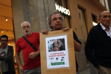 Activists from CGT take part in a protest in front of a Mango store in Malaga