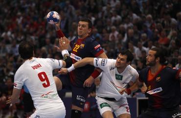 FC Barcelona's Rutenka is fouled by HSV Hamburg's Lijewski and Vori during their men's Champions League Handball final in Cologne