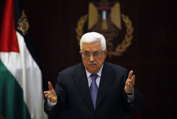 Palestinian President Abbas gestures during a Palestinian Liberation Organization executive committee meeting in Ramallah
