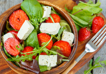 Vegan salad with tofu and strawberries. Love for a healthy vegan food concept