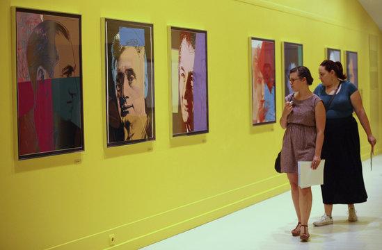 Visitors look at artworks at Pera Museum in Istanbul