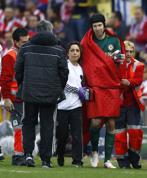 Chelsea's goal keeper Petr Cech is escorted off the pitch by the team doctor after being injured during their Champion's League semi-final first leg soccer match against Atletico Madrid at Vicente Calderon stadium in Madrid