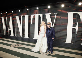 Lady Gaga and Elton John arrive at the Vanity Fair Oscar Party in Beverly Hills