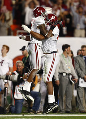 Alabama's Clinton-Dix celebrates an interception against Notre Dame with teammate Hubbard during the third quarter of their NCAA National Championship college football game in Miami