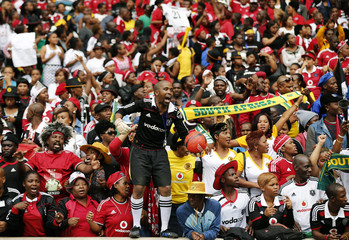 A soccer fan dressed as a goalkeeper dances ahead a funeral service of South African national soccer team captain,and goalkeeper, Senzo Meyiwa in Durban