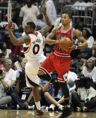 Bulls guard Rose takes a loose ball away from Hawks guard Teague in the second half of their Eastern Conference semifinals NBA basketball game in Atlanta.