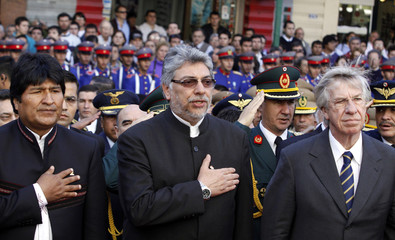 Bolivia's President Morales, Paraguay's President Lugo and Uruguay's Vice President Astori attend Paraguay's Independence Day celebrations at the Heroes' Pantheon, in Asuncion