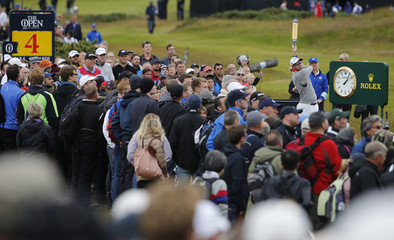 Scott of Australia watches his tee shot on the fourth hole during the second round of the British Open golf championship on the Old Course in St. Andrews, Scotland