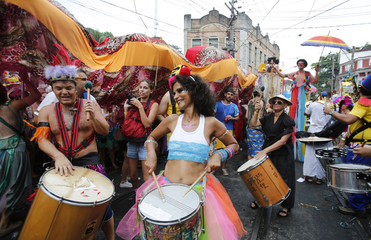 """Revellers perform in the annual block party known as the """"Ceu na Terra"""", one of the many carnival parties to take place in the neighbourhoods of Rio de Janeiro"""