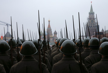 Russian servicemen dressed in historical uniforms take part in a rehearsal for a military parade at the Red Square in Moscow