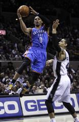 Oklahoma Thunder Westbrook goes to the basket against San Antonio Spur Green during their NBA game in San Antonio, Texas
