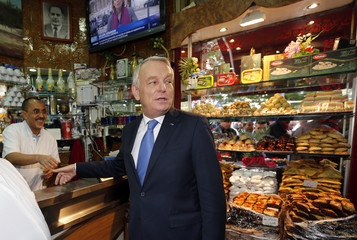 French Prime Minister Jean-Marc Ayrault visits a Tunisian pastry shop during a one day visit in Marseille