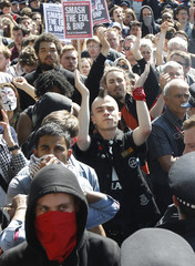 'Unite Against Fascism' demonstrators shout across police lines at 'English Defence League ' demonstrators, during a protest in Whitehall, organised following the recent killing of British soldier Lee Rigby in Woolwich, in London