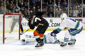 Ducks' Cogliano scores a power play goal past Canucks' Luongo and Salo during the second period of their NHL hockey game in Anaheim