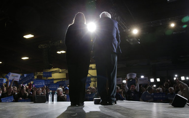 U.S. Democratic presidential candidate and U.S. Senator Bernie Sanders is joined onstage by his wife Jane at his Super Tuesday rally in Burlington