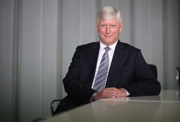 Schmitz, CFO of German utility RWE, poses at their headquarters in Essen