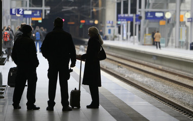 people wait for trains at the station of the Cologne-Bonn airport following a warning strike of locomotive drivers of Germany's mighty train drivers union GDL to press pay demands