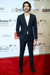 Indian actor Dev Patel poses during the opening of the 12th Dubai international film festival, in Dubai