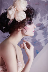 dirty make-up woman in wedding dress and flowers