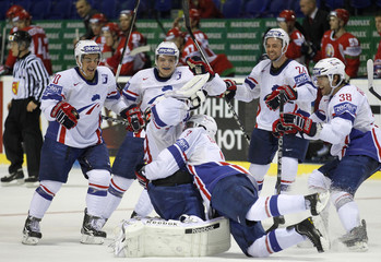 France's players celebrate after they defeated Belarus 2-1 in overtime of their preliminary round Group B game at the Ice Hockey World Championships in Kosice