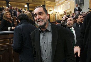 Antiguedad, congressman of pro-Basque independence coalition Amaiur, arrives for the forming of the new Spanish parliament in Madrid